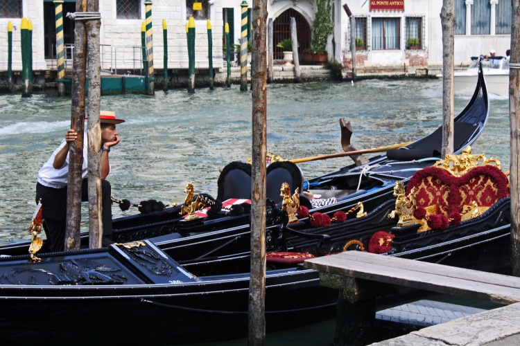 Gondoliers await to show you the best view of Venice.